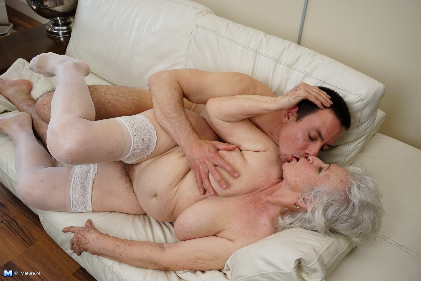 toy boy playing around with a hairy granny