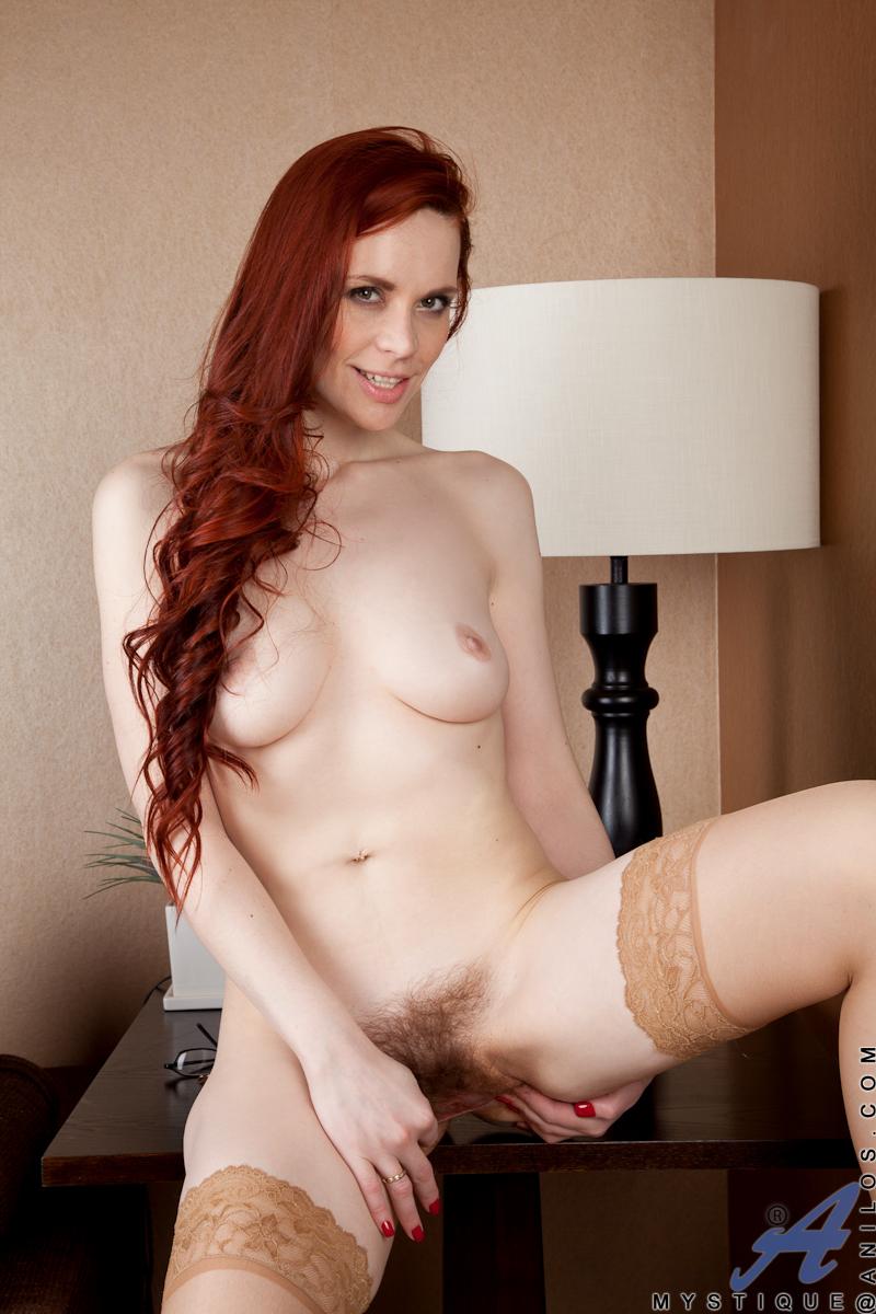 Cute chubby redhead spreading