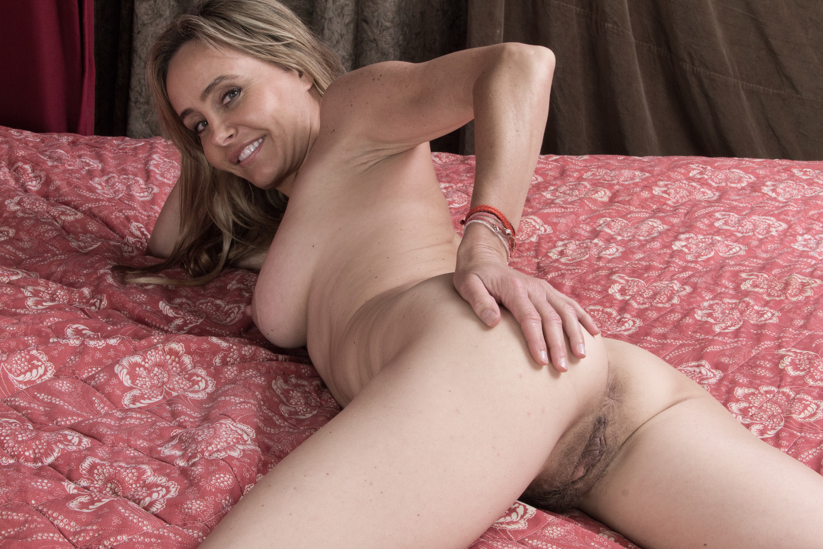 Hairy milf on bed