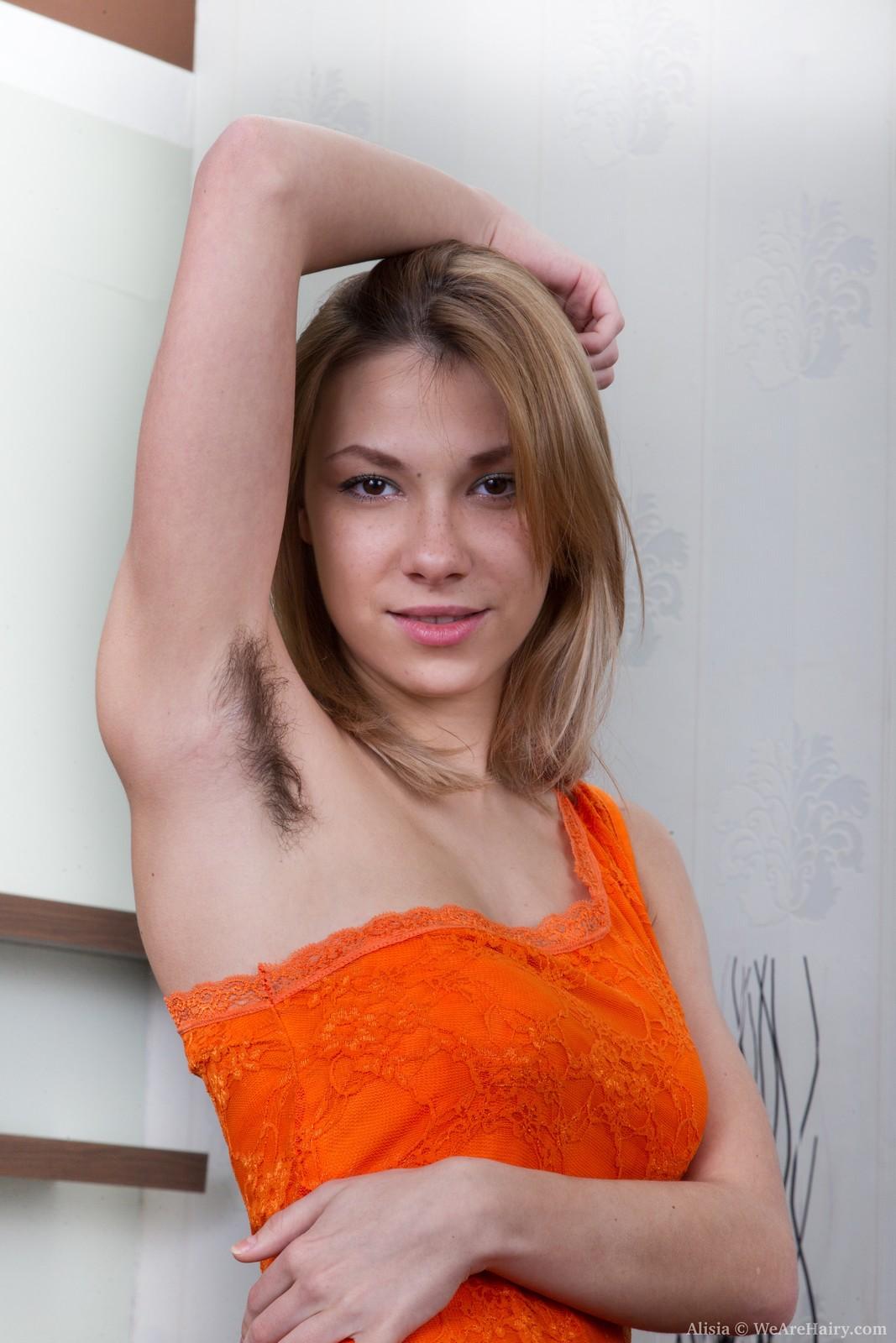Alisia puts on sexy striptease on sofa